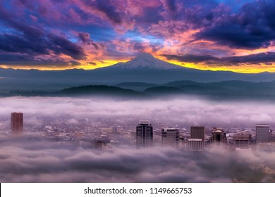Dramatic colorful sunrise over Mount Hood and foggy Portland Oregon city downtown