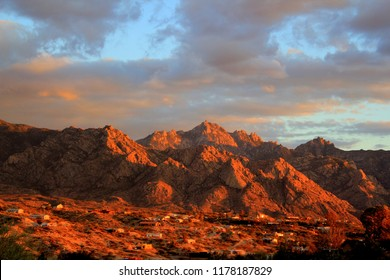 Dramatic colorful sunset with orange and pink clouds over the panoramic Pusch ridge Santa Catalina mountains in the Tucson Arizona desert