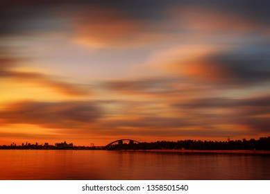 Dramatic colorful sunset over Dnipro river in Kiev, Ukraine, travel background with long exposure