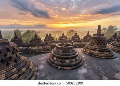 Dramatic and colourful sunrise seen from the Borobudur