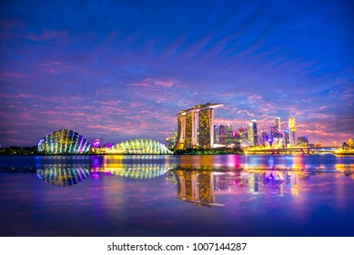 Dramatic colourful sunset sky at Singapore Skyline and skyscrapers on Marina Bay at Singapore city, Singapore
