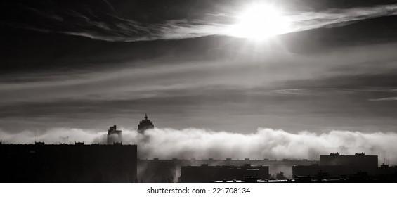 Dramatic cumulonimbus fog clouds under the black sky over city of Kiev, Ukraine