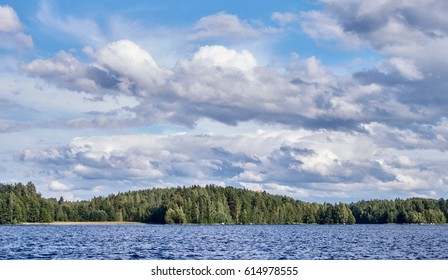 Dramatic cumulus clouds in the bright summer day scene in Finland.