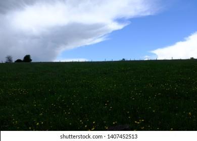 Dramatic Cumulus or Cumulonimbus clouds in Eifel Germany