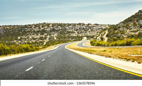 Dramatic curve road with strong perspective point of view.
