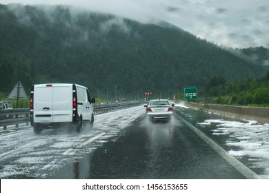 Dramatic and dangerous weather conditions on the road of Croatia through the blurred windshield of car - heavy hail storm
