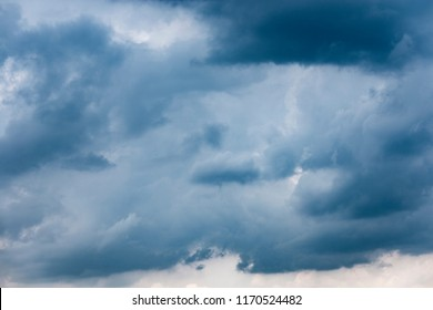 dramatic, dark, blue cloudy sky overlay for compositing or mate painting.