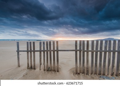 dramatic and dark cloudscape over beach and ocean in Spain, before storm
