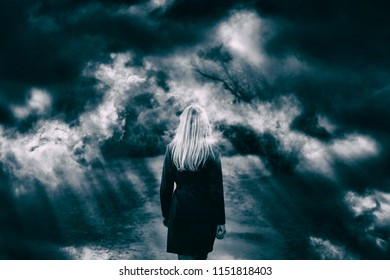 Dramatic dark cloudy sky with girl walking. Double exposure effect used.