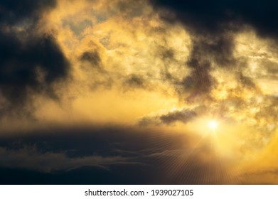 Dramatic dark cumulus cloud sunset sky with rays. Climate background