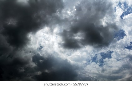 dramatic dark storm clouds passing over head