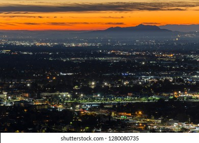 Dramatic dawn view of the San Fernando Valley neighborhoods in the city of Los Angeles, California.