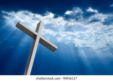 Dramatic deep blue Jesus light shining down on cross