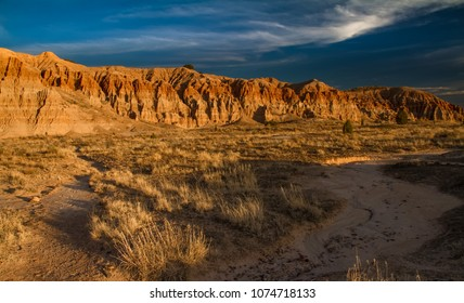 Dramatic desert landscape of Cathedral Gorge State Park at sunset in Nevada, USA.