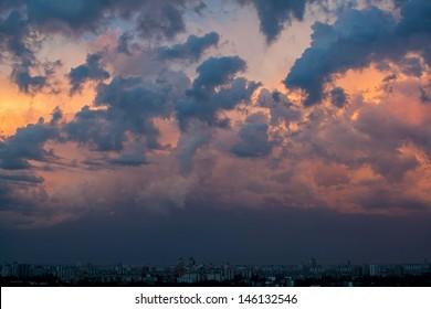 Dramatic evening cloudscape in city