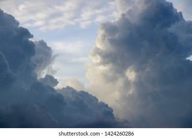 Dramatic evening cloudy sky. Full of cumulonimbus and cumulus clouds in the evening light.