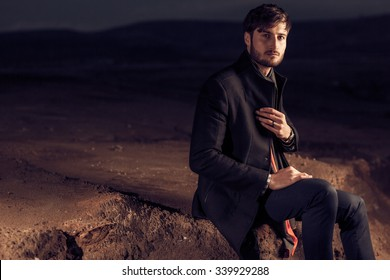 Dramatic fashion series of images of a handsome male model in a desert location