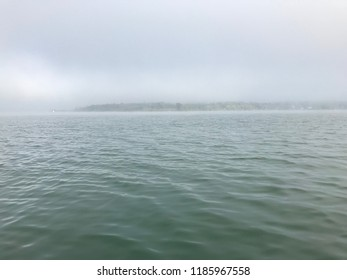Dramatic and foggy morning on Ammersee in Bavaria, Germany