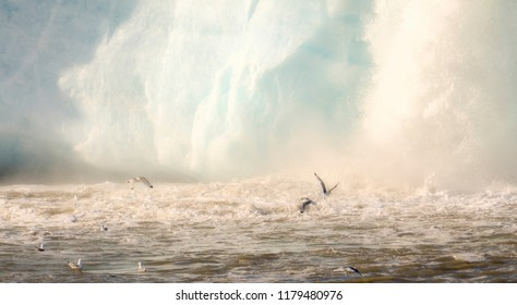 Dramatic Glacier Waterfall Scene with Churning Ocean and Glaucous Gulls Flying in the Arctic Ocean on the Coast of Spitsbergen Svalbard Archipelago in Northern Norway
