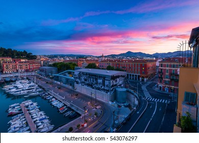Dramatic gorgeous sunrise over the quiet town of Nice, France