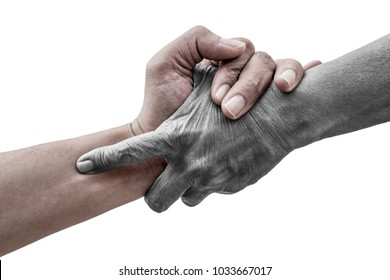 Dramatic help hands holding together representing friendship, partnership, help and hope, donation, assistance. Helping old, poor and hunger. Live and dead.