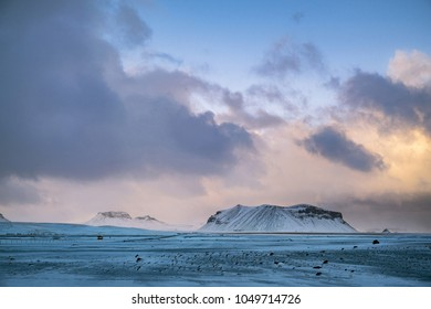 Dramatic icelandic landscape with snow covered mountains.