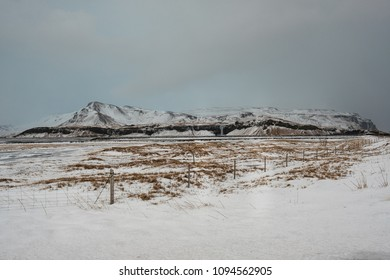 Dramatic icelandic landscape with snow covered mountains. Cold winter day in Iceland.