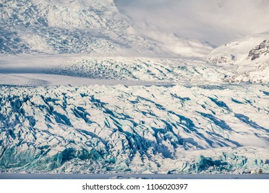 Dramatic Icelandic landscape in winter. Huge ice glacier covered with snow. Winter in Iceland.