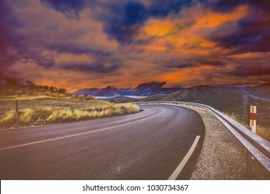 Dramatic image of Panoramic view with A long curve road in the early morning against sunrise sky,cloudy and foggy,New zealand,journey concept