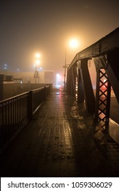 Dramatic industrial vintage river bridge scenery at night with illuminating fog in Chicago