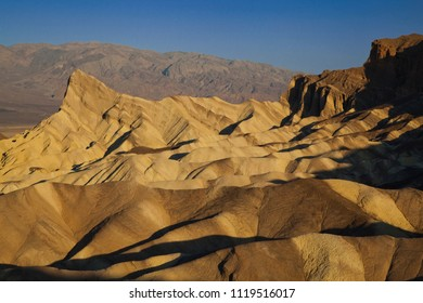 dramatic landscape at death valley hills at sunrise