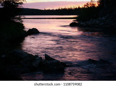 Dramatic landscape with sunset on lake