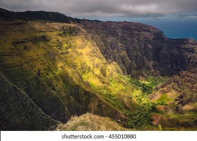 Dramatic landscape view of Na Pali coastline, cliffs and valley, Kauai, Hawaii, USA