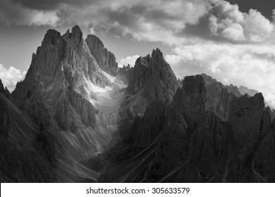 Dramatic light in Dolomites Mountains. Black and white landscape