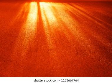 Dramatic light rays on city asphalt background