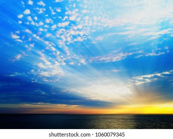 Dramatic light rays over the ocean surface backdrop