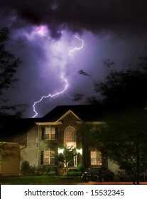 Dramatic lightening storm over suburban home