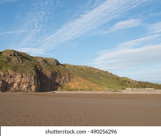 Dramatic Limestone Cliffs of Brean Down, part of the Mendip Hills, from the Beach Below in the Late Afternoon Sun in Autumn on the Bristol Channel in Somerset, England, UK