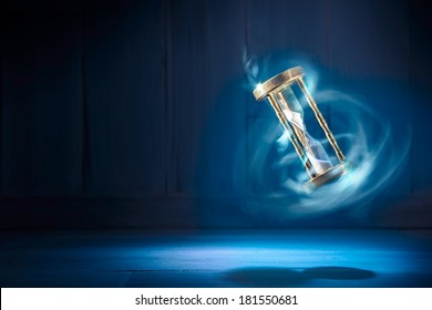 dramatic lit image of hourglass, time concept