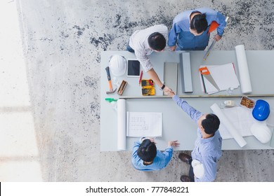 Dramatic moment. Asian Engineer or Business Partner team handshake together,We Confident to successful. Team start up a business hope and trust on construction site. business,teamwork concept