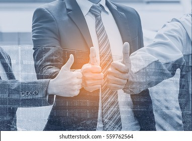 Dramatic moment,Double exposure People Hand Assemble Corporate Meeting Teamwork Concept. Team starts a business hopes and happy with thumb up on construction site background