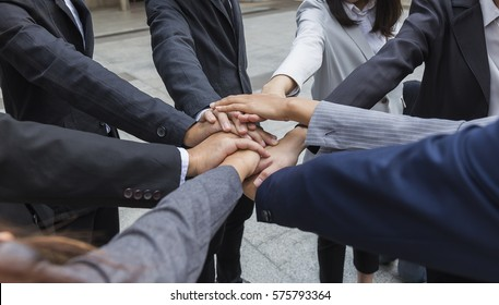 Dramatic moment,People Hand Assemble Corporate Meeting Teamwork Concept,Teamwork,friendship,unity,cooperation and gesture concept,Business group with hands together teamwork