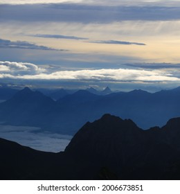 Dramatic morning sky over Mount Stanserhorn and other mountains of the Swiss Alps.