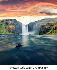 Dramatic morning view of Skogafoss Waterfall. Fantastic summer sunrise of Skoga river. Amazing outdoor scene of Iceland, Europe. Beauty of nature concept background.