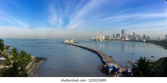 Dramatic Mumbai Skyline of Prabhadevi, lower parel with Haji Ali Dargah, ocean and dramatic clouds