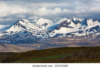 Dramatic nature with snowy mountains in Iceland.