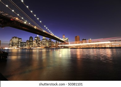 Dramatic New York City skyline with a cruise boat passing in the foreground