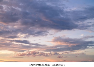Dramatic orange grey purple sky and cloudy at sunset for background