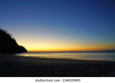 Dramatic orange sunset over the Playa Virador beach in Peninsula Papagayo in Guanacaste, Costa Rica