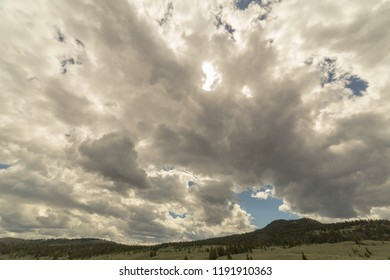 dramatic overcast sky above hillside